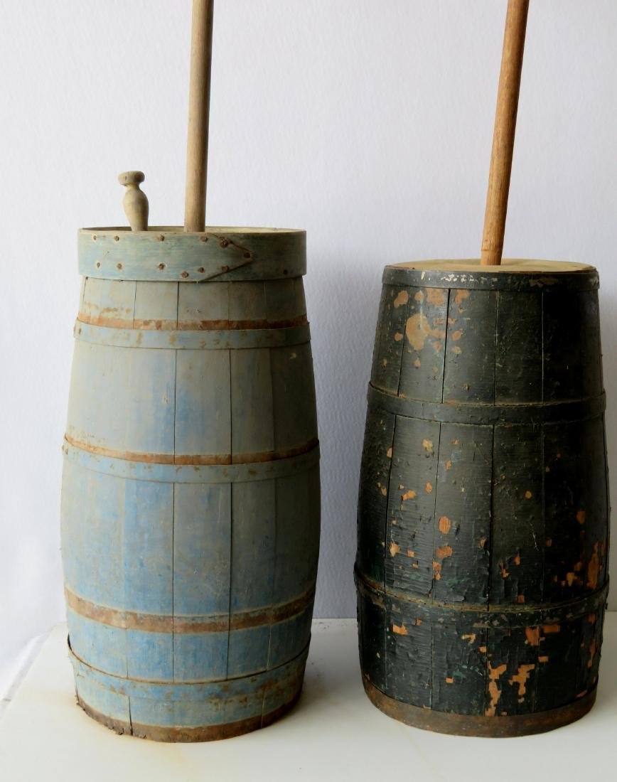 Two floor standing butter churns: 1) With layers of old