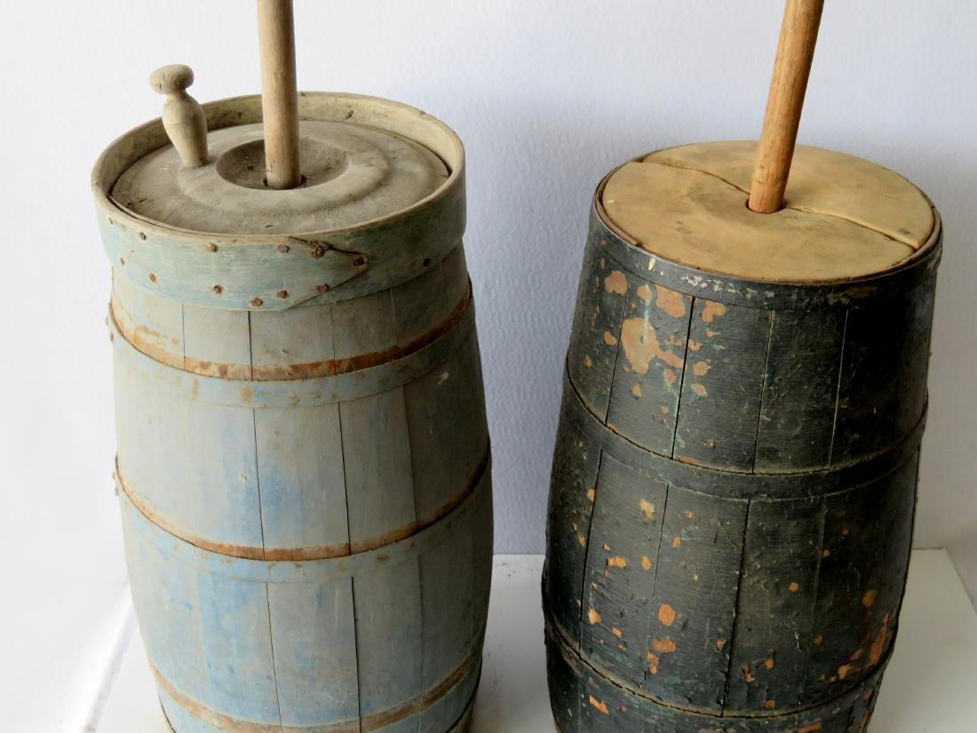 Two floor standing butter churns: 1) With layers of old - 2