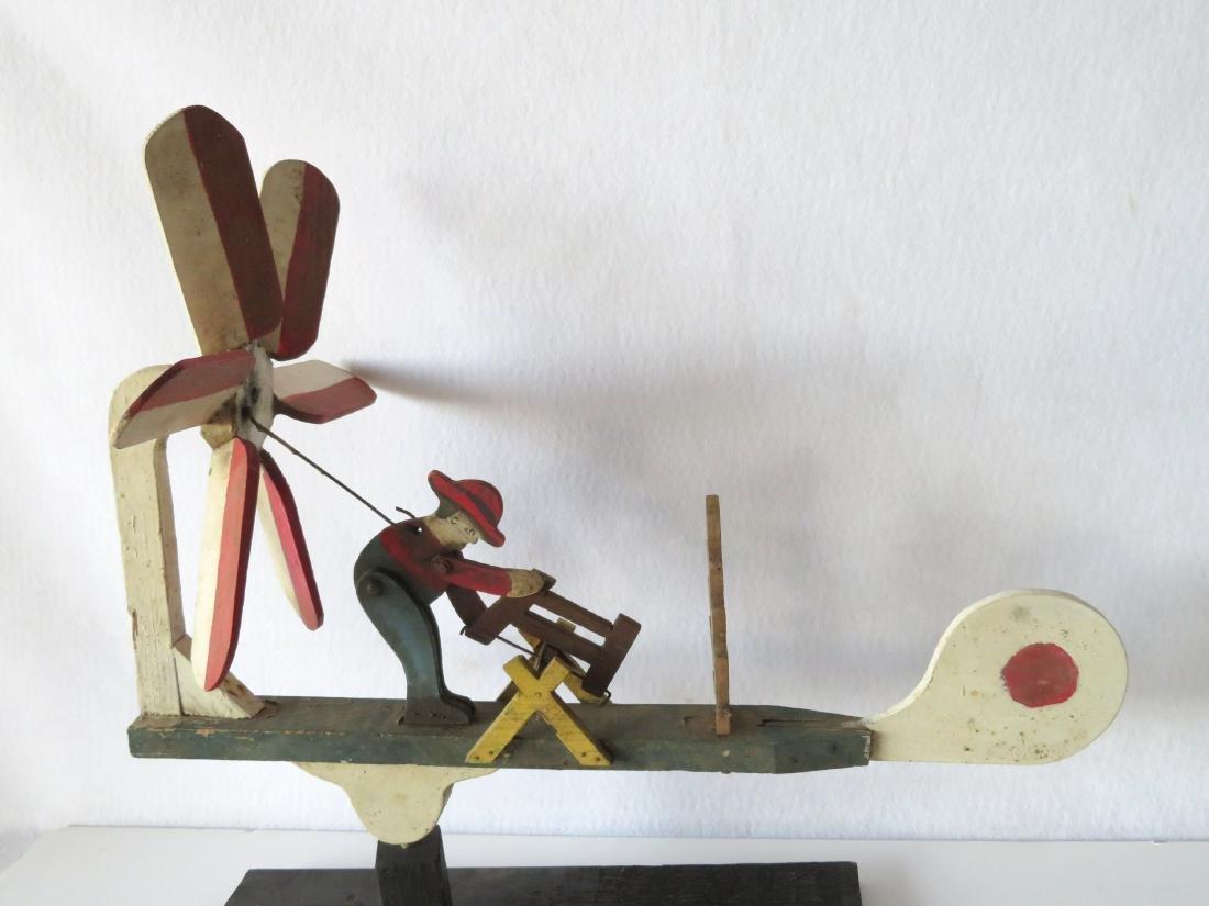 Three folk art whirligigs of man sawing log adjacent to - 4