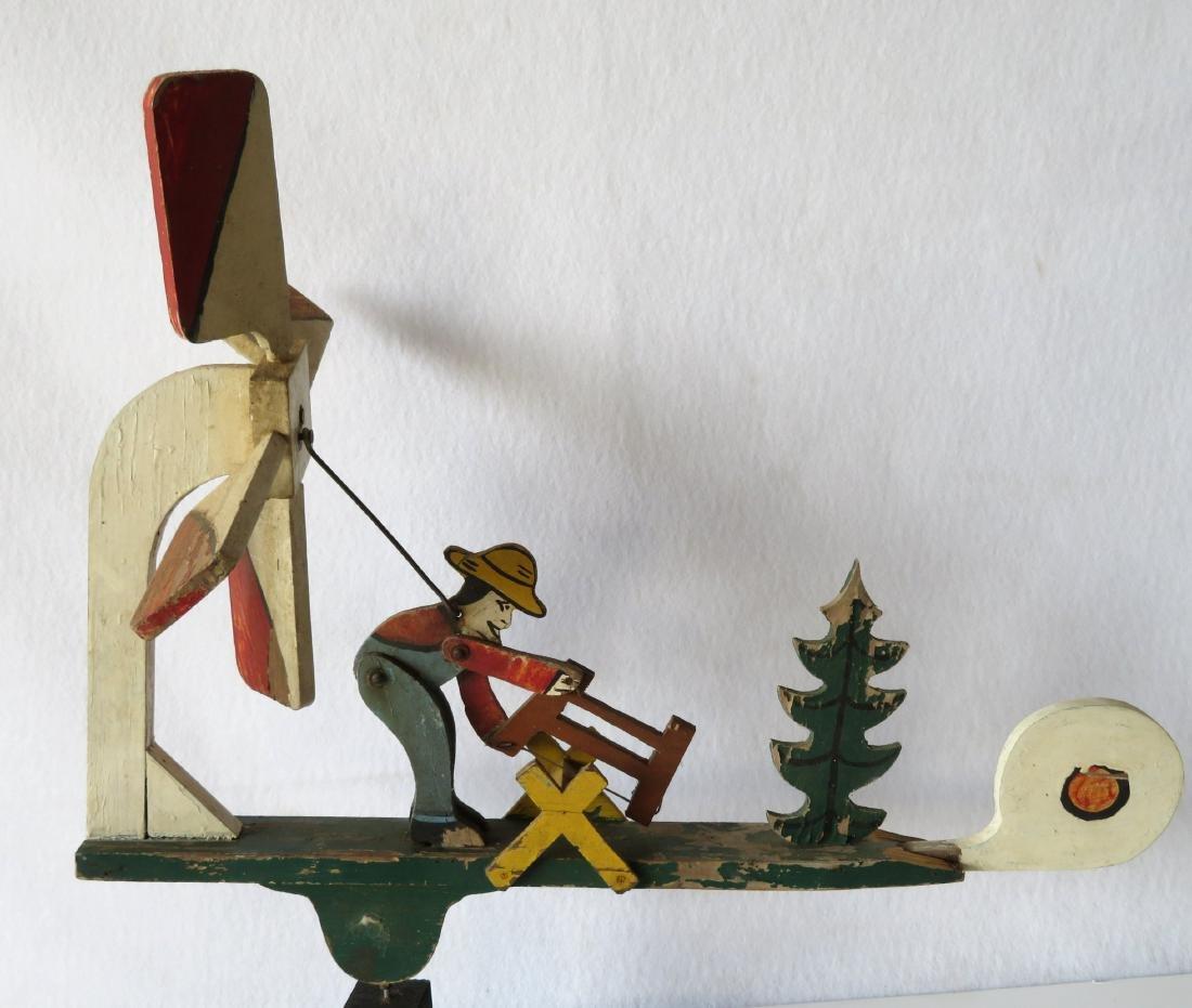 Three folk art whirligigs of man sawing log adjacent to - 5