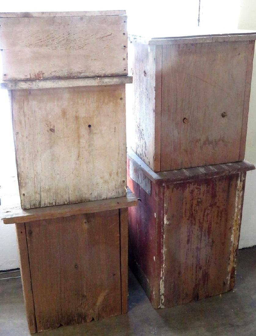 Four early wooden beehives in old paint, one in 2 - 2