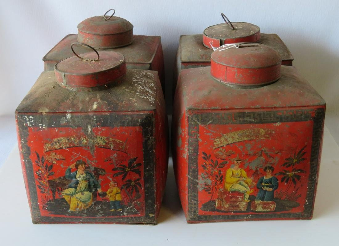 Four tin oriental tea bins in original red paint with
