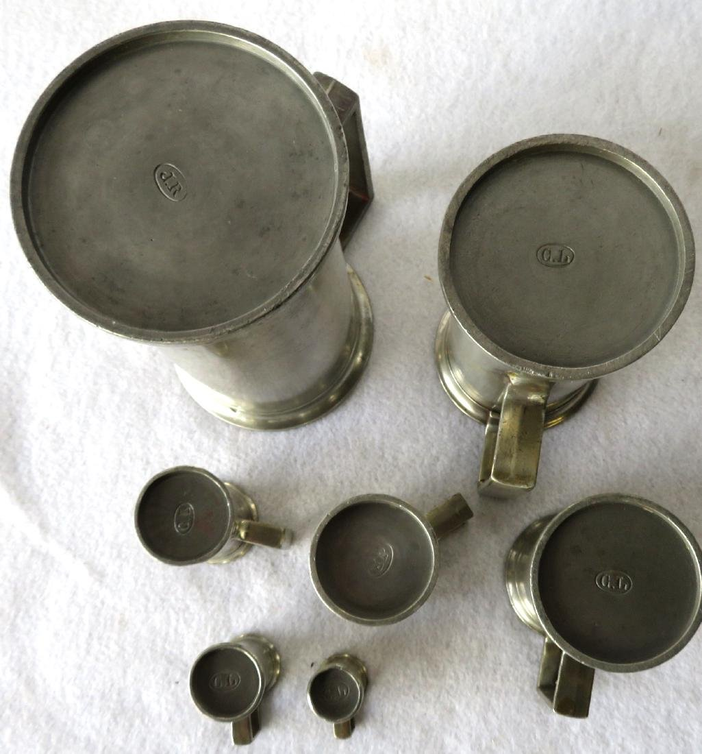 Set of 7 graduated pewter measures with touch mark GL - 6