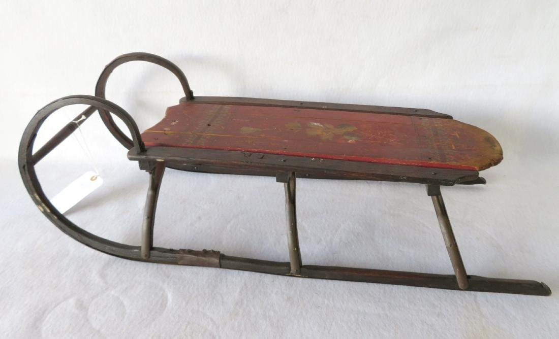 Child's hand painted sleigh with floral and scroll