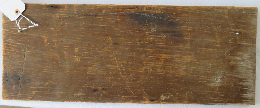 An architectural wooden panel having a carved oval - 3