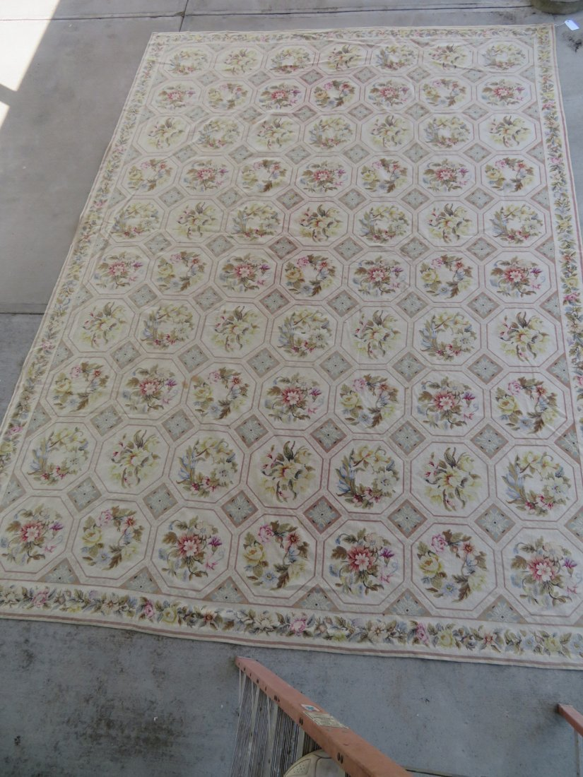 Large Aubusson floral needlepoint rug.