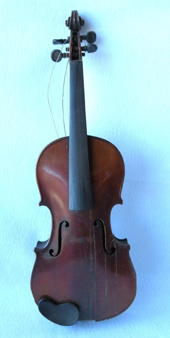 Violin with strong tiger maple on neck and back.