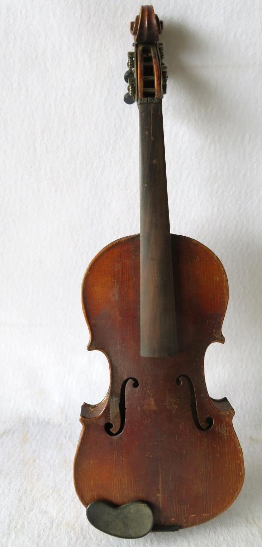 Violin in original case - no bow. Interior with paper
