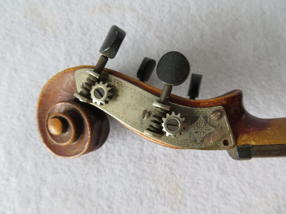 Violin in original case - no bow. Interior with paper - 2
