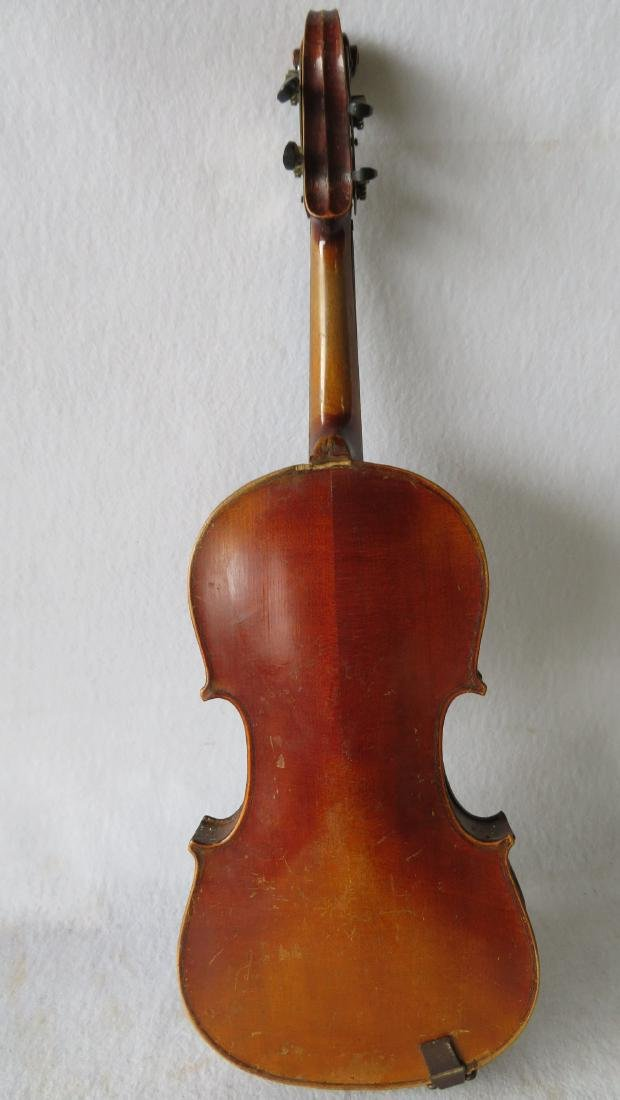 Violin in original case - no bow. Interior with paper - 3