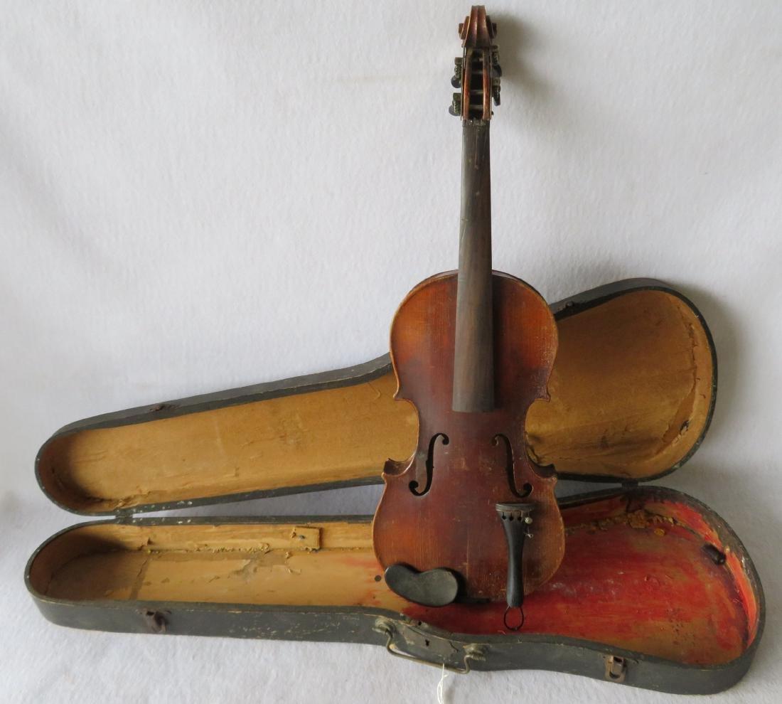Violin in original case - no bow. Interior with paper - 4