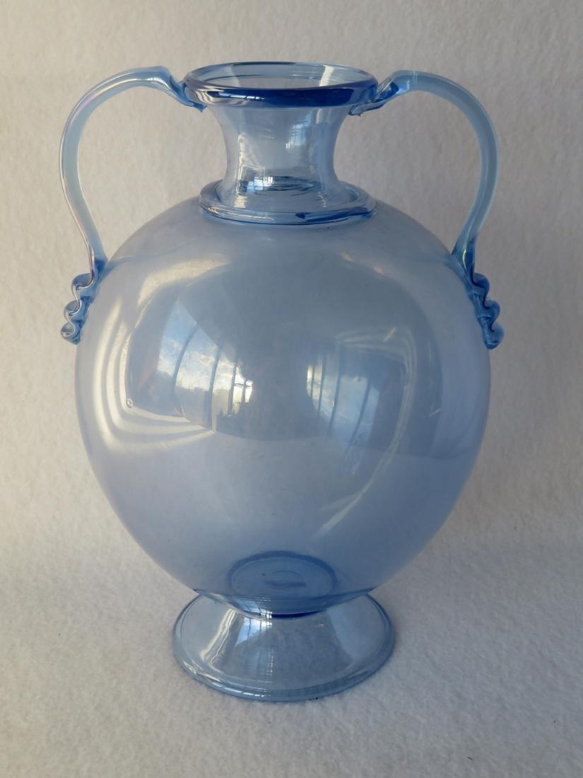 Hand blown double handle transparent blue vase on