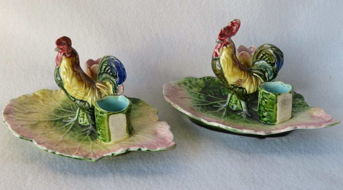 Two majolica porcelain table candle sconces each having