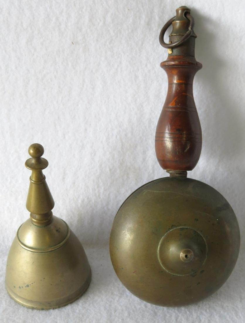 Two early brass bells: Fireman's hand held muffin bell