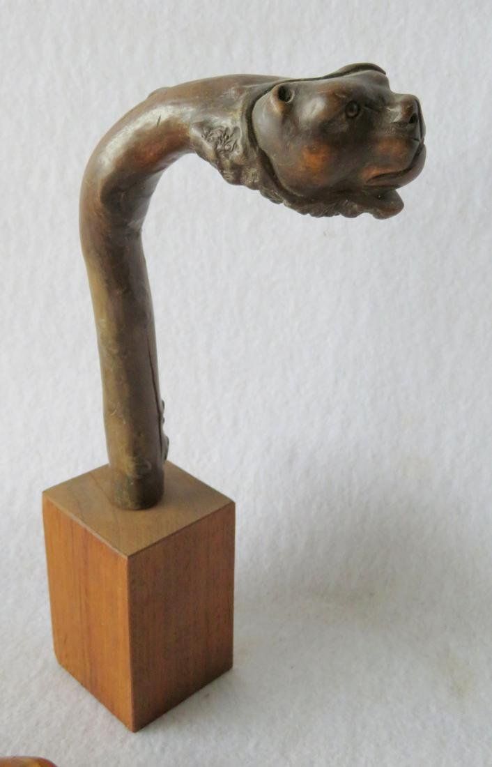 Three carved cane handles: 1) Burl wood with carved dog - 2
