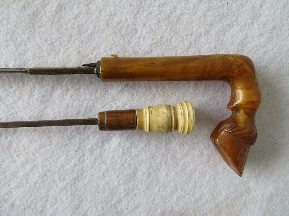 Three carved cane handles: 1) Burl wood with carved dog - 4