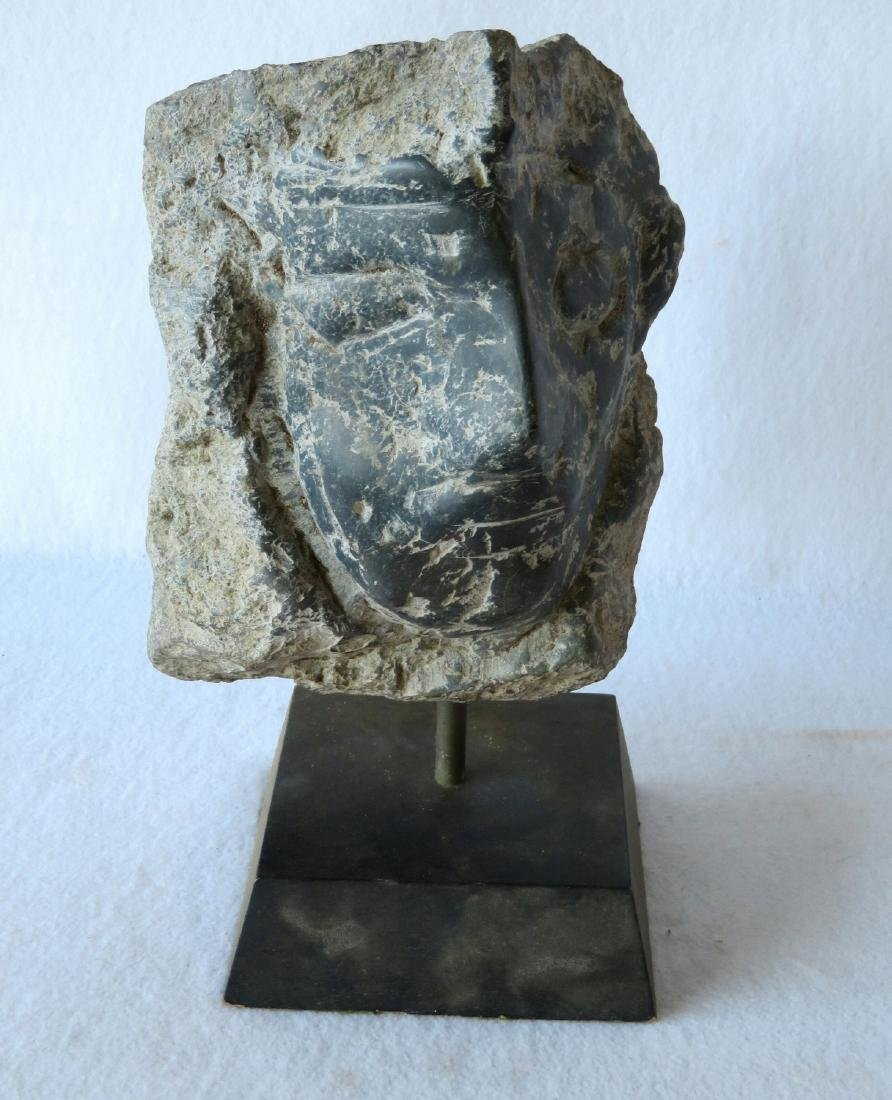 Carved stone sculpture of a stylized man - 19th century