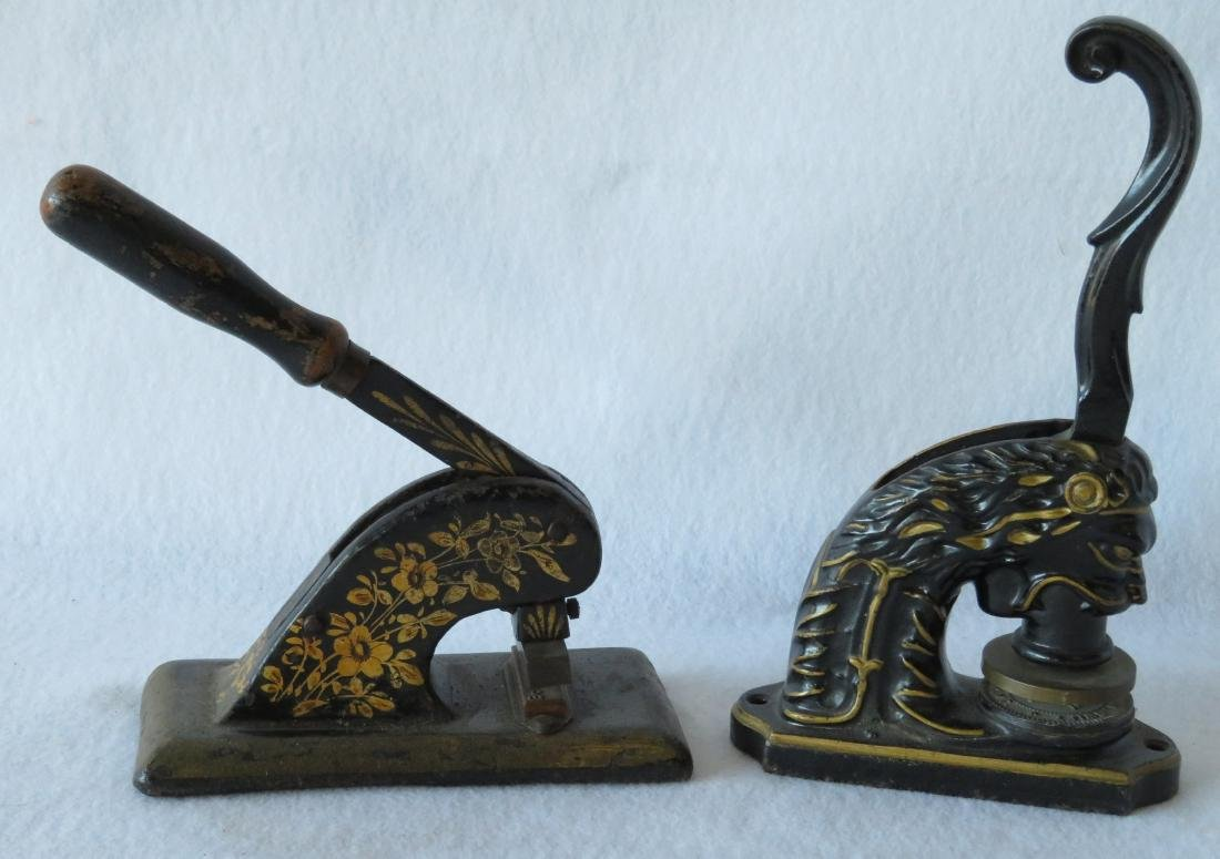 Two cast iron seals with gold leaf decorations, late
