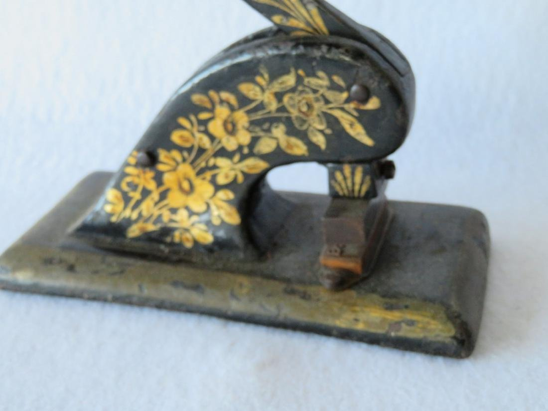 Two cast iron seals with gold leaf decorations, late - 2