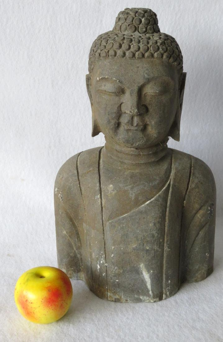 Stone sculpture of a Buddhist man - early to mid 20th
