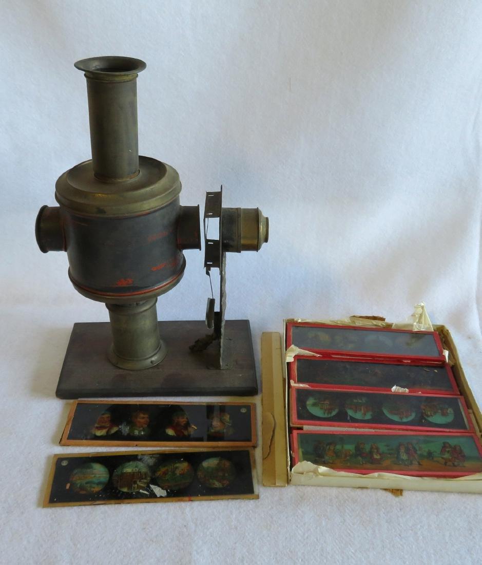 Tin Magic Lantern with slides, traces of original