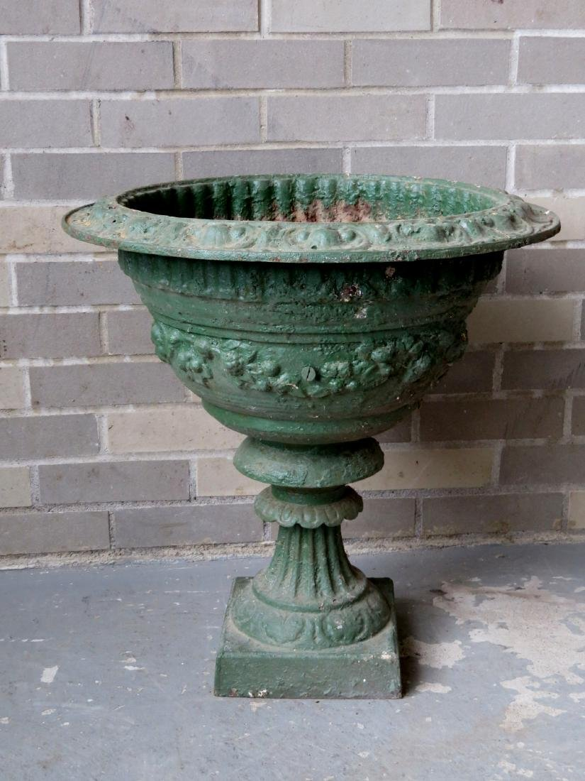 Cast iron garden urn, profusely decorated with flowers