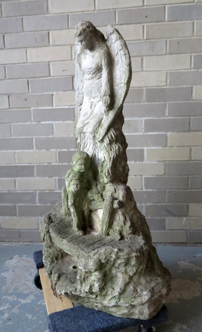 Old concrete garden sculpture of a Guardian Angel,