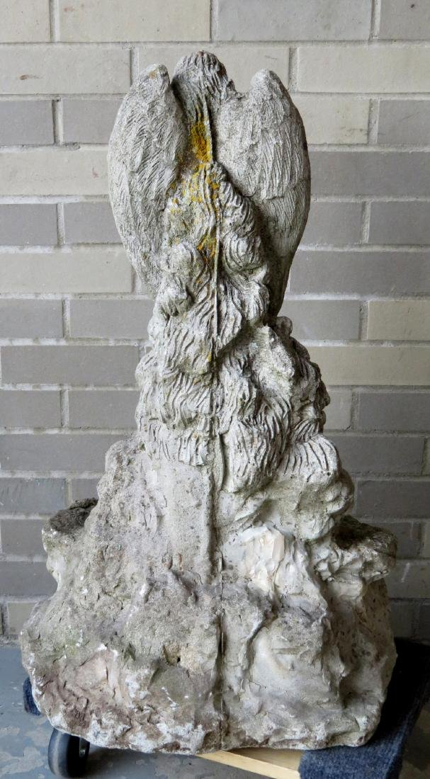 Old concrete garden sculpture of a Guardian Angel, - 4