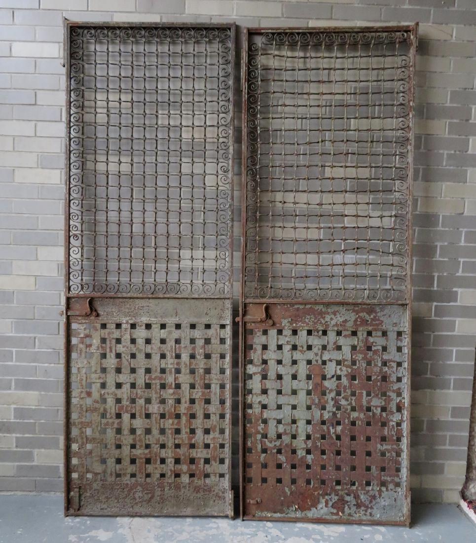 Two large near matching decorative cast iron