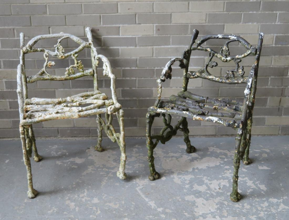 Two matching cast iron garden chairs in rustic twig