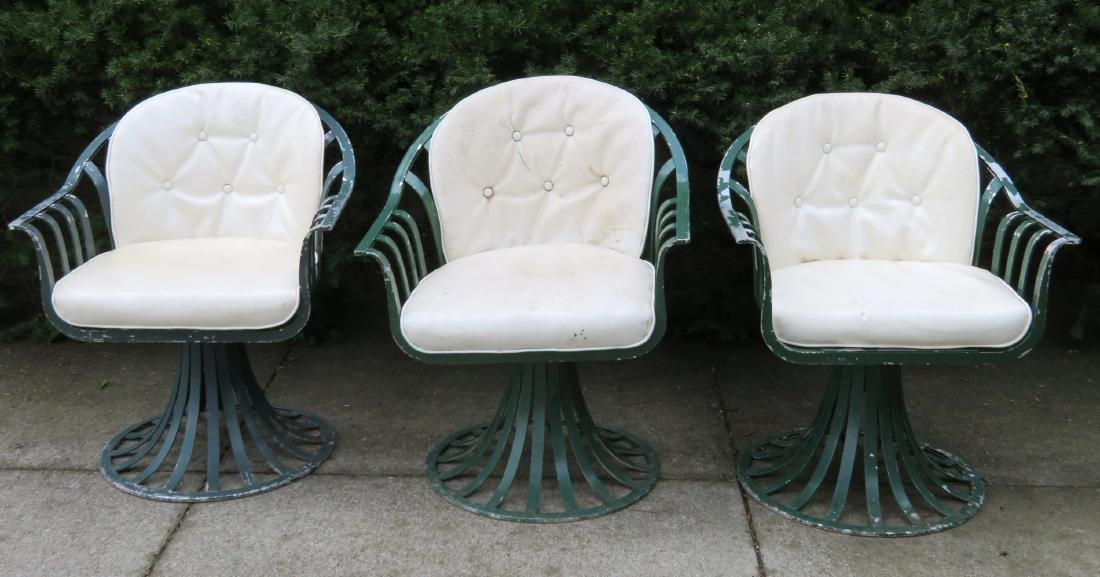 Three matching Woodard aluminum patio chairs in green