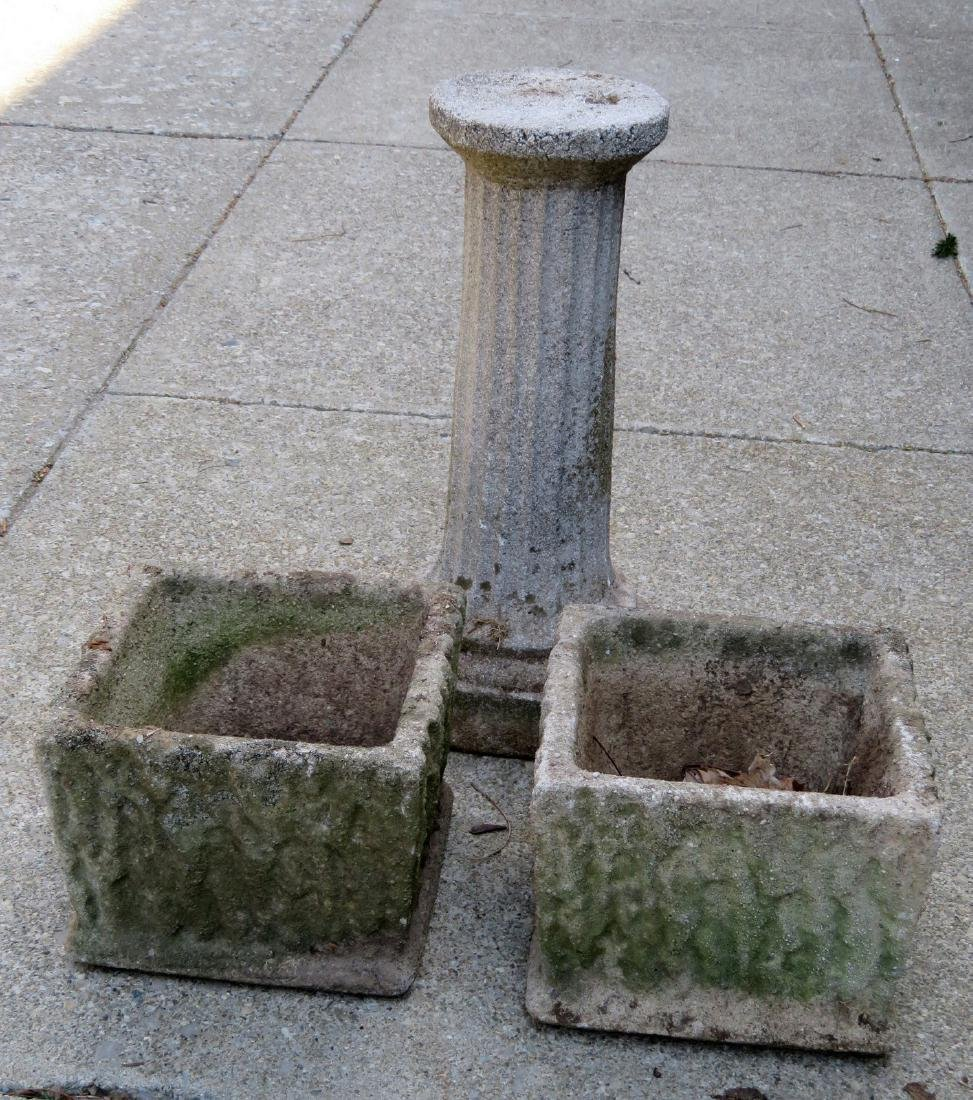 Three concrete garden items including 2 matching urns