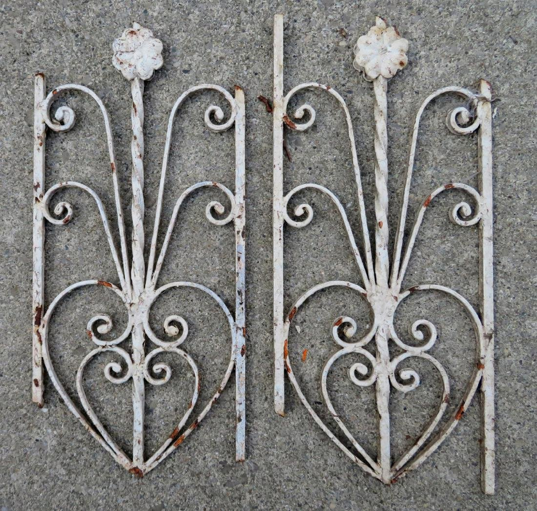 Two wrought iron gate fragments in the form of flowers,