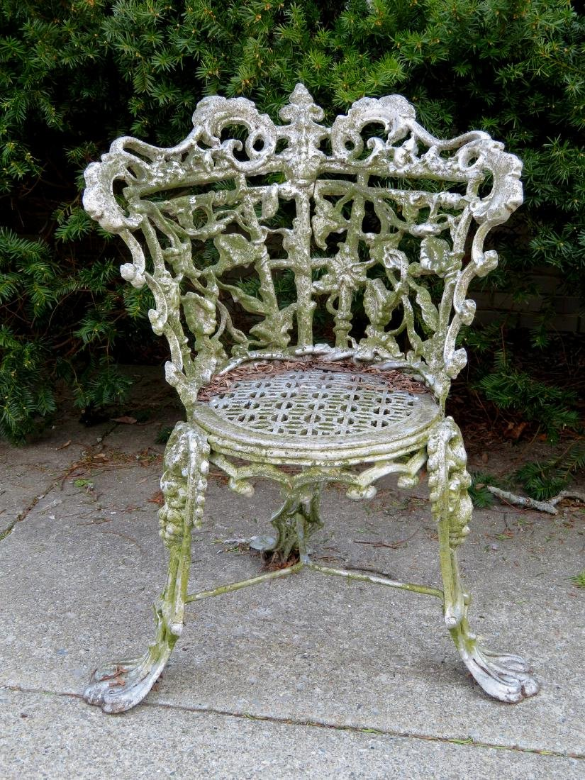 Cast iron classical garden seat decorated with scrolls,