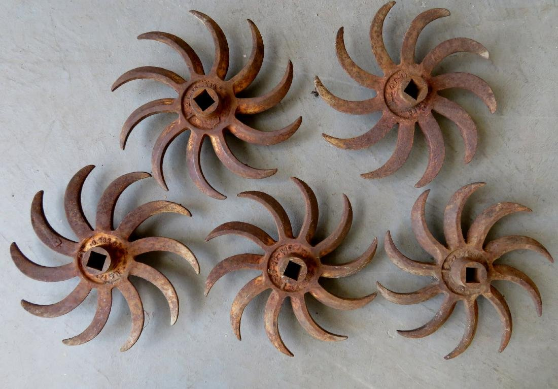 Grouping of 5 cultivating iron wheels - each