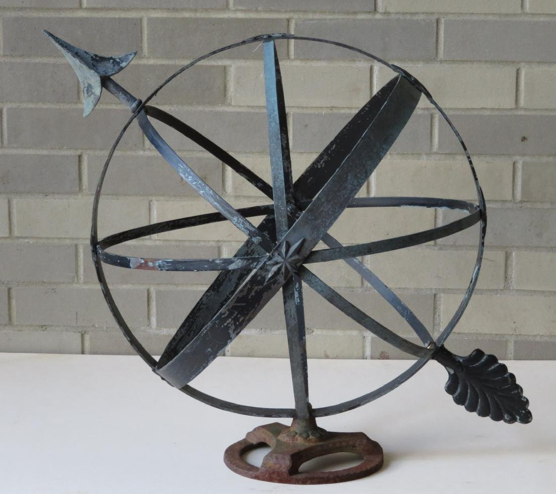 Armillary sphere in copper with a zinc arrow, mounted