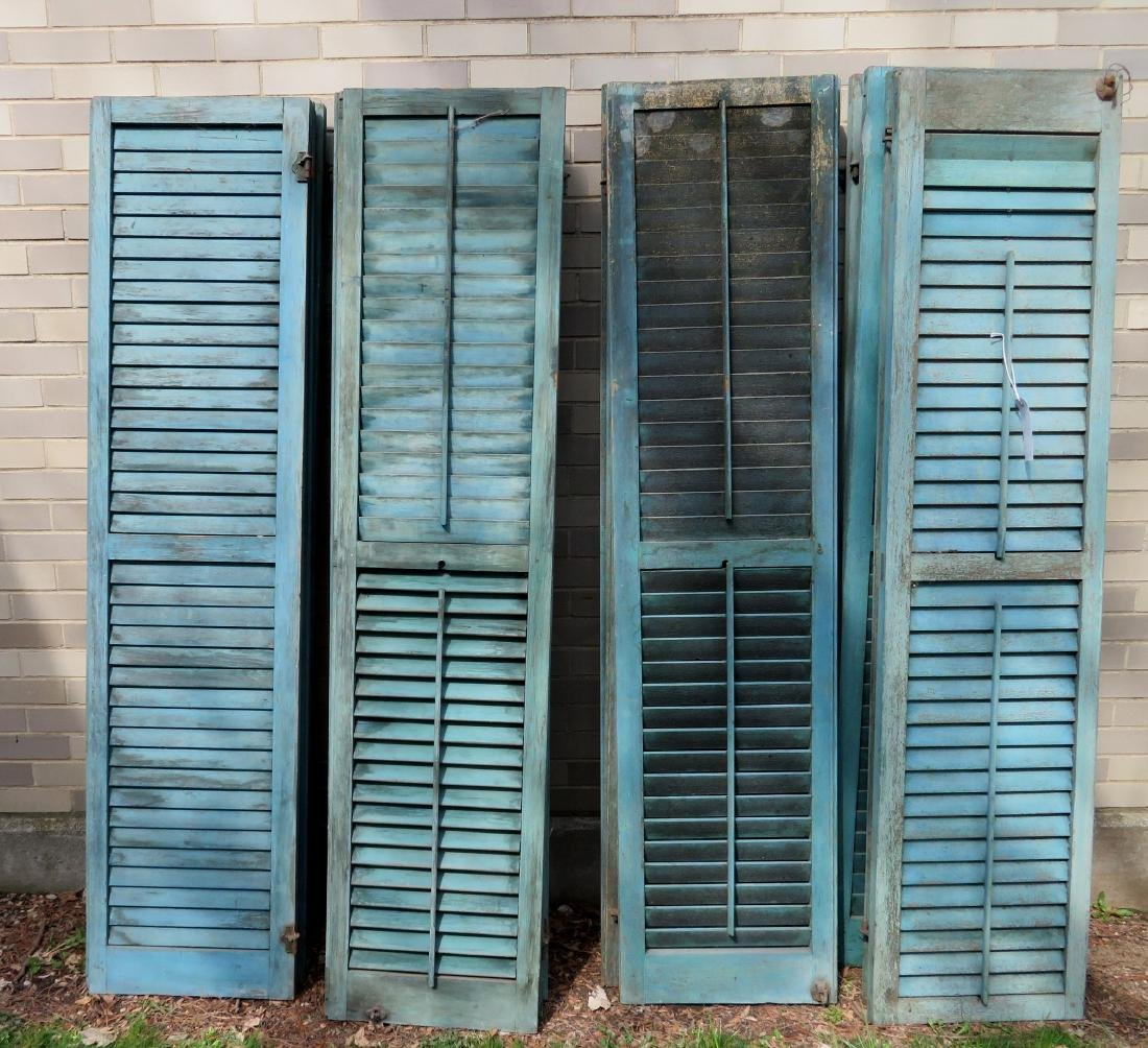 Grouping of 14 old shutters in original blue paint,