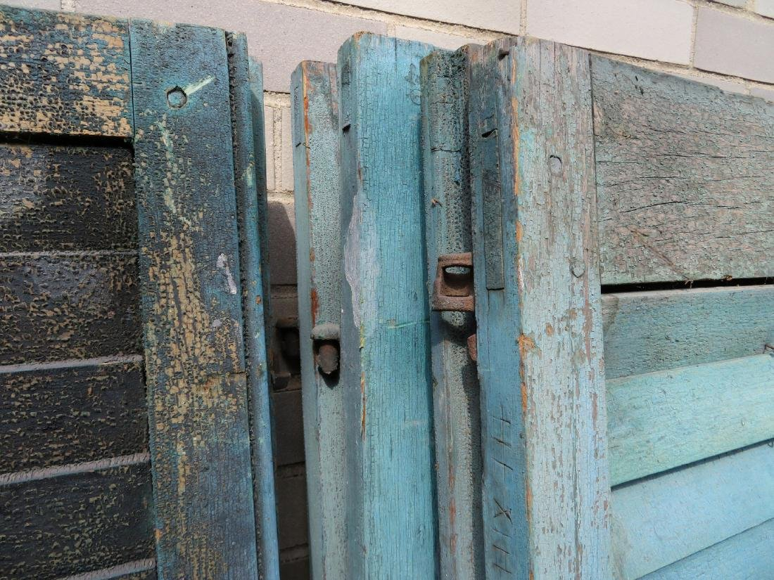 Grouping of 14 old shutters in original blue paint, - 2