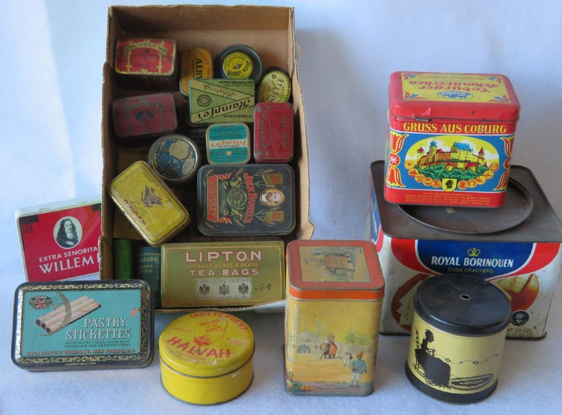 "Grouping of advertising tins including ""Quick Loader"""