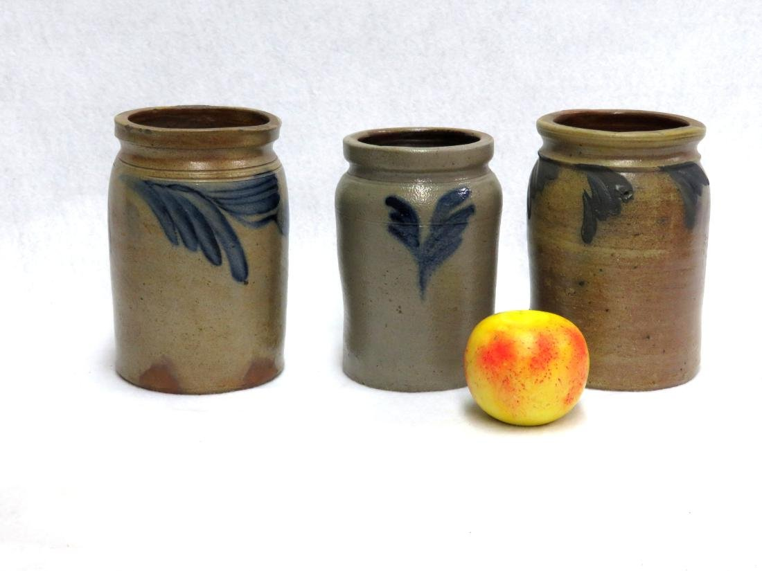 Three small stoneware pantry jars decorated with