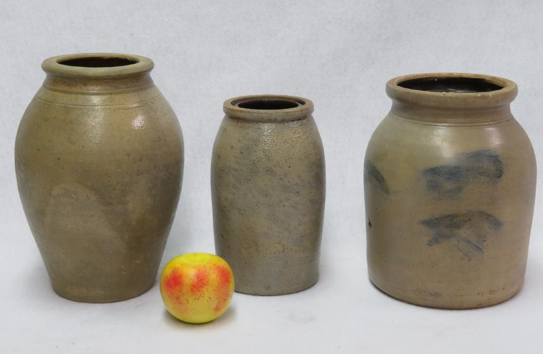 Three stoneware pantry jars including one with blued