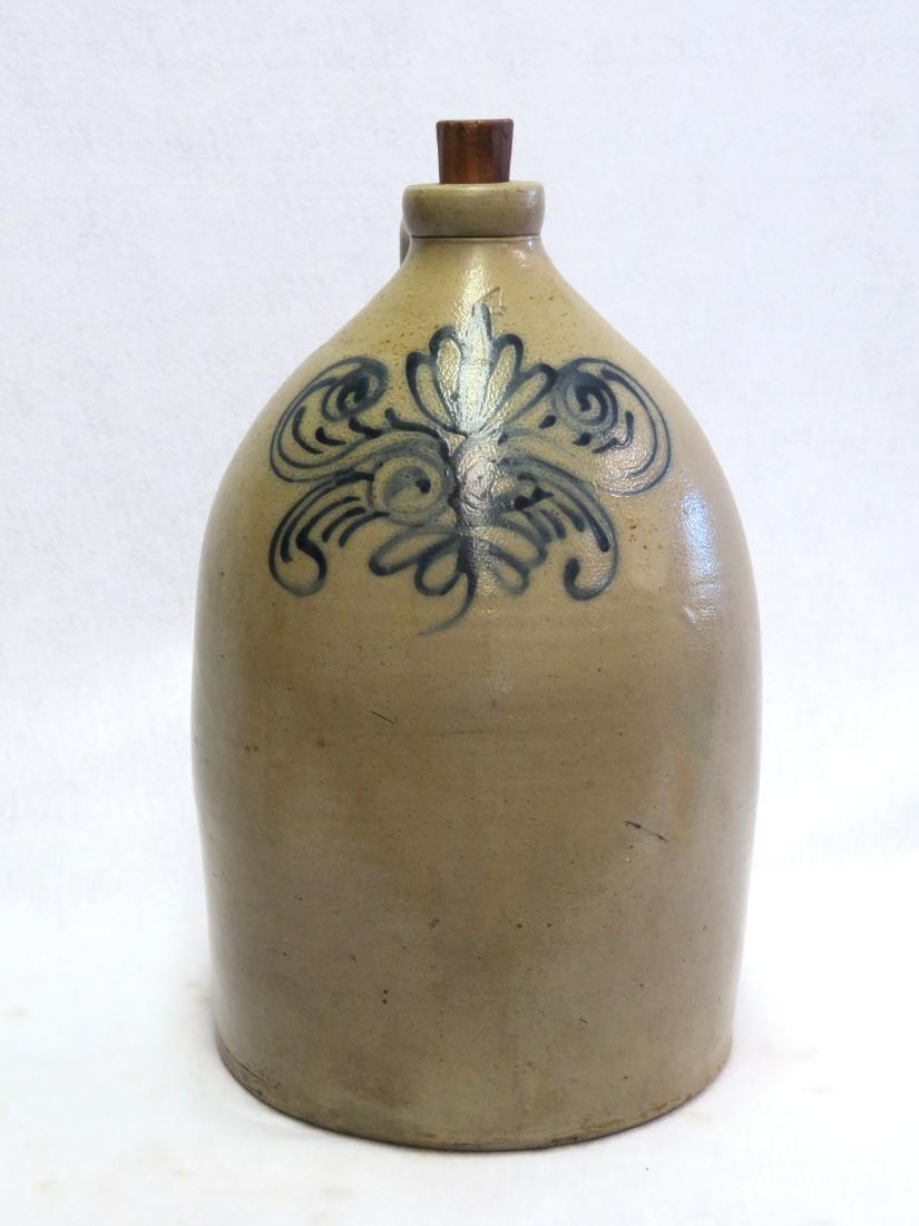 Stoneware 4 gallon jug, decorated with a stylized