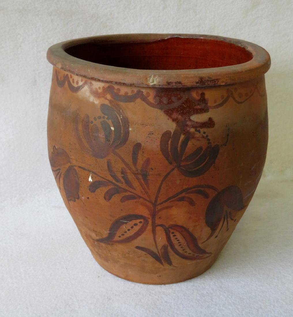 Unglazed redware jar decorated in blue with tulips and