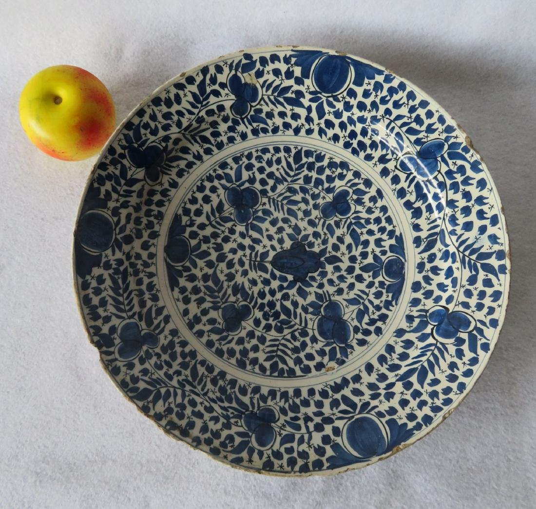 Tin glazed charger, probably Delft,  decorated in blue