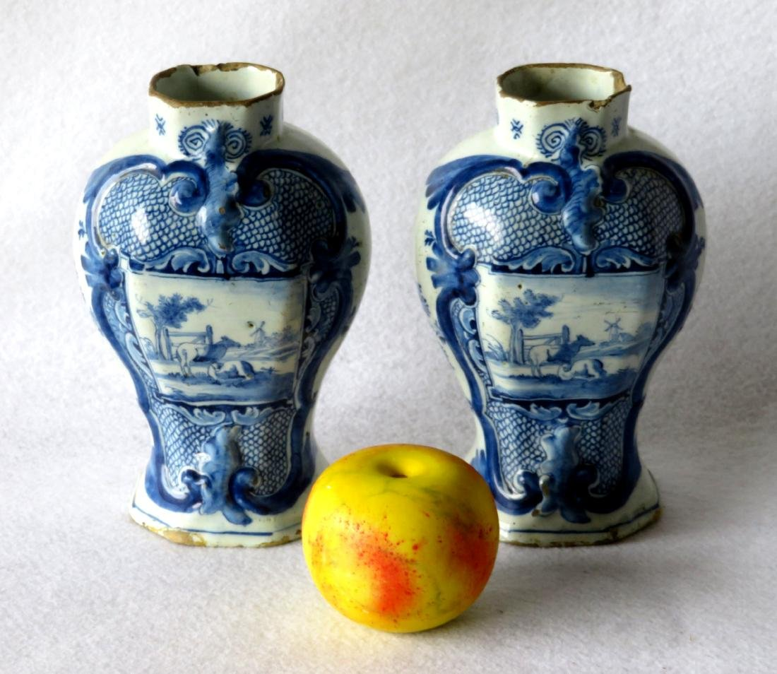 Pair of tin glazed Delft vases, hand decorated in blue