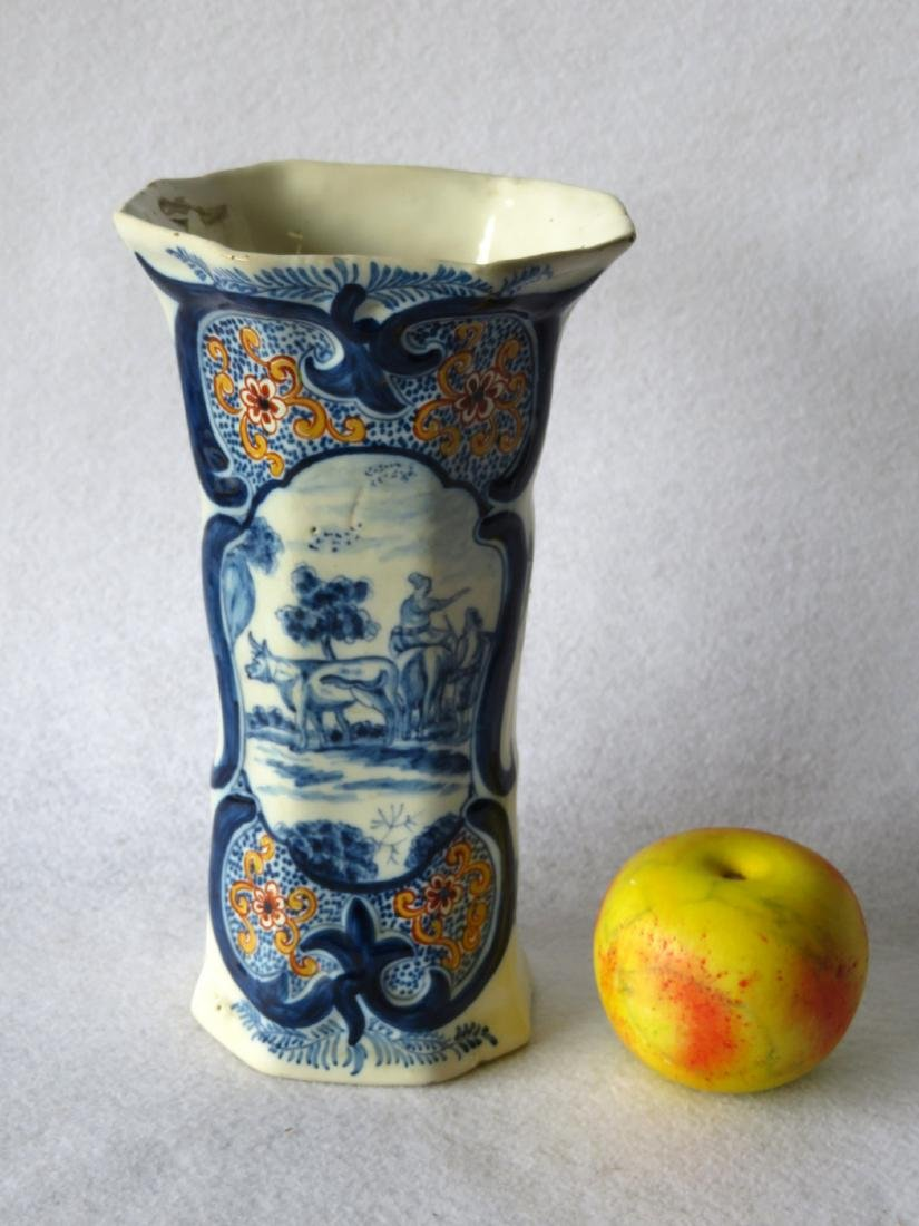 Tin glazed vase decorated in blue, orange, green and