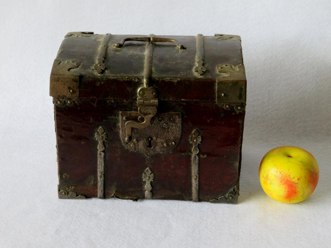 An early leather covered document box with hand forged