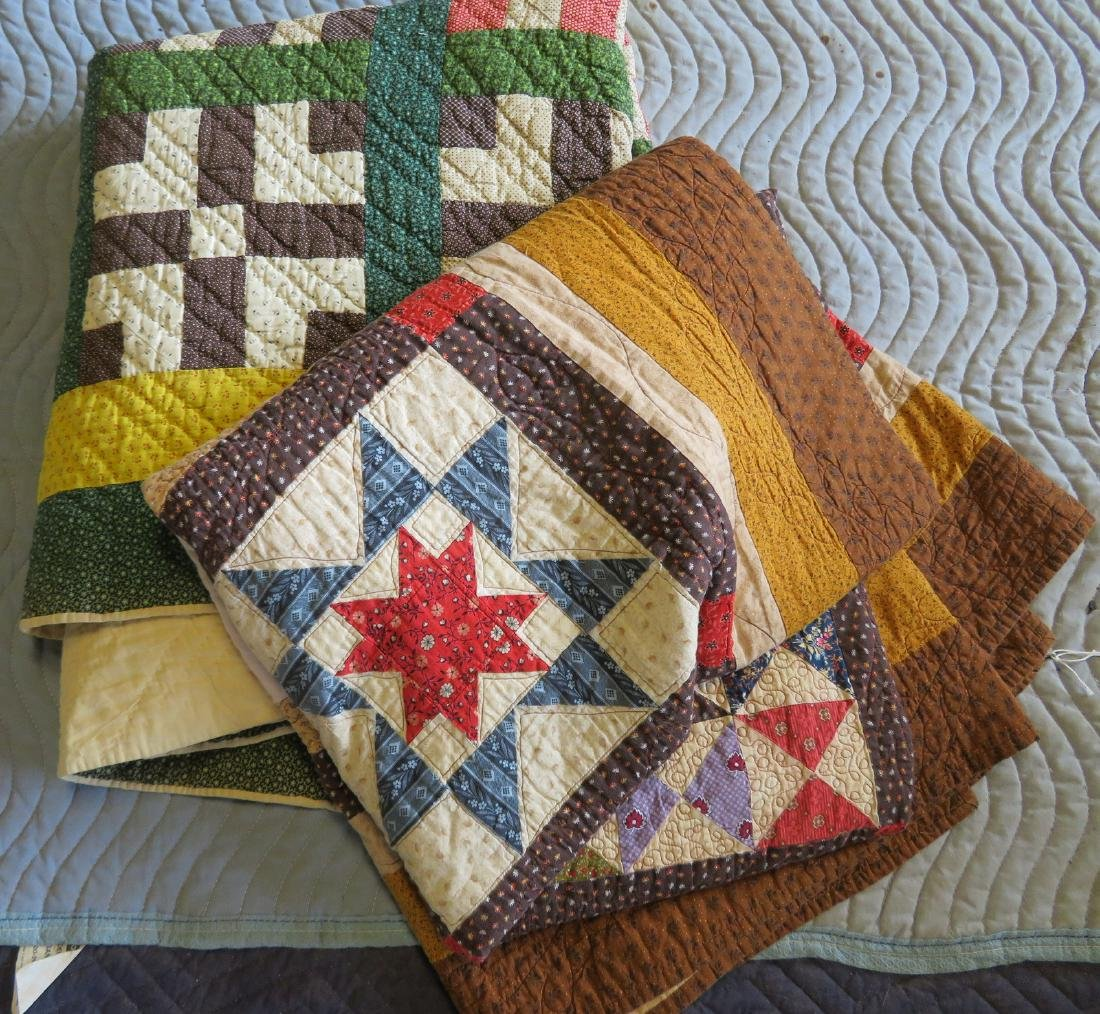 Two patchwork quilts: 1) Hand sewn with double border,