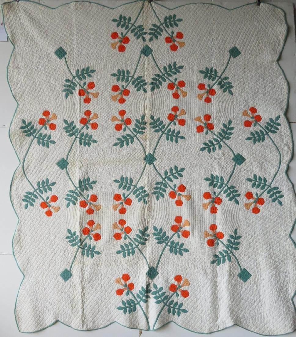 Colorful floral applique quilt in green, yellow and