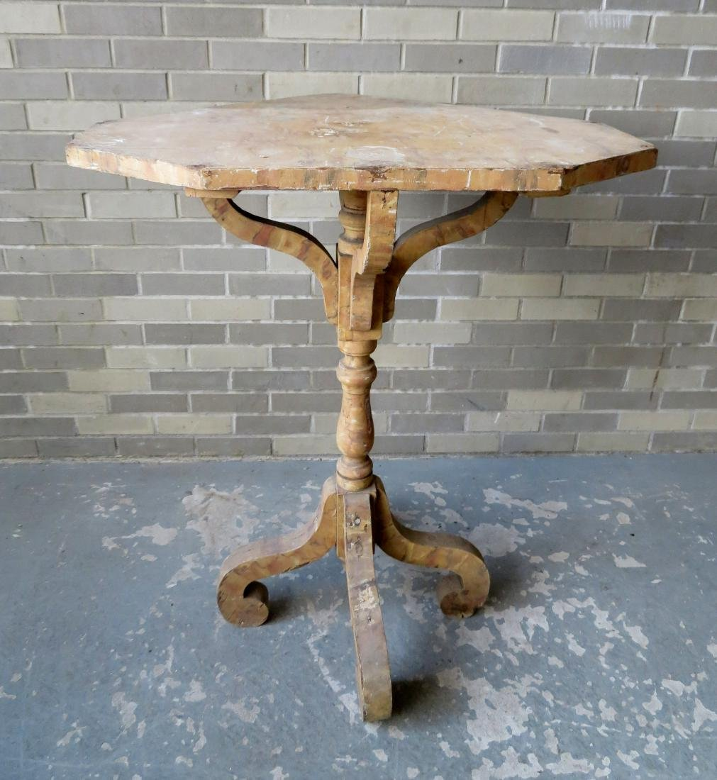 An unusual grain painted country corner plant stand on